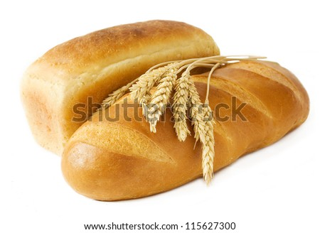 Bread loaf and ear of wheat isolated on white background