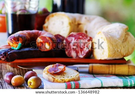 Bread, meat, olives and portuguese wine