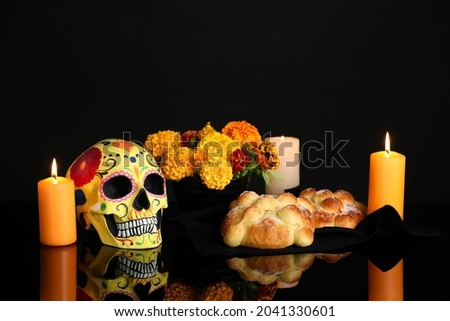 Bread of the dead and painted skull on dark background. Celebration of Mexico's Day of the Dead (El Dia de Muertos) Stock fotó ©