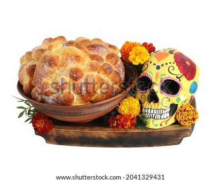 Bread of the dead and painted skull on white background. Celebration of Mexico's Day of the Dead (El Dia de Muertos) Stock fotó ©