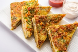 Bread Omelette is a quick and easy breakfast from India. Fresh bread slices dipped into egg batter with spices and shallow fried. served with tomato ketchup and tea