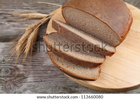Bread on a wooden board. Still life.