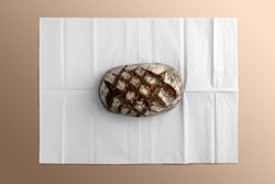 Bread on blank wrapping paper, bakery branding mockup, empty space to display your logo or design.
