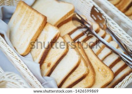 Bread on the table prepared for guests and participants of the event. Top view.  Catering guest meals during event. Quick mini snacks dish.  #1426599869