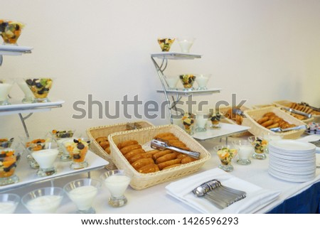 Bread, pies on the table prepared for guests and participants of the event. Top view.  Catering guest meals during event. Quick mini snacks dish.  #1426596293