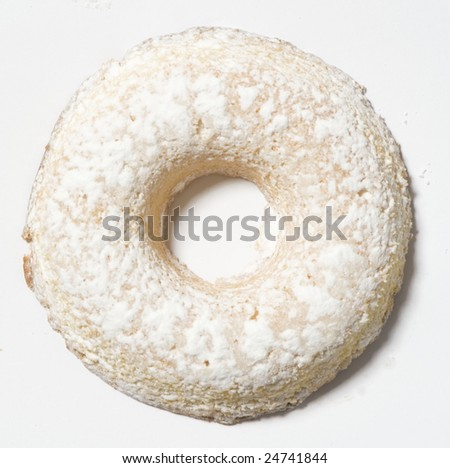 Bread rings shaped cake icing sugar on white background