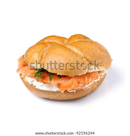 bread roll  served with sliced smoked salmon isolated.