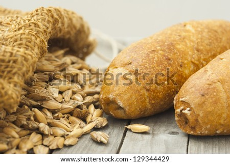 bread rolls and ingredients on rustic wooden