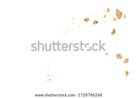 Bread slices and crumbs isolated on white background. Top view  Stockfoto ©