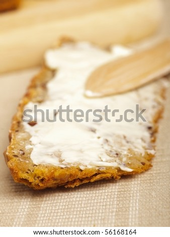 bread slices on a board with a knife