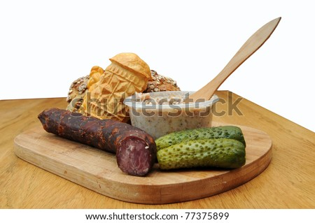 Bread, smoked cheese, sausage and other traditional food isolated on white background