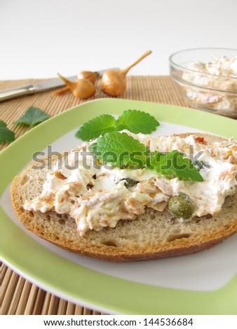 Bread spread with tuna and cream cheese