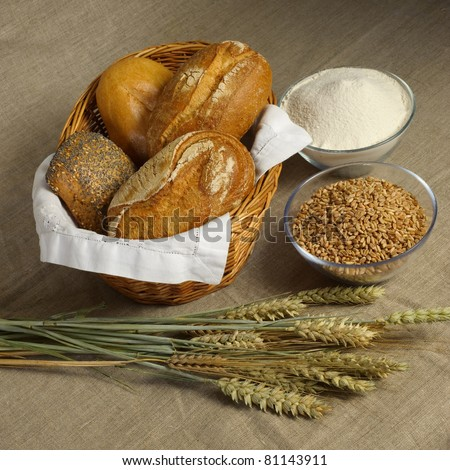 Bread still-life with wheat, bread and flour