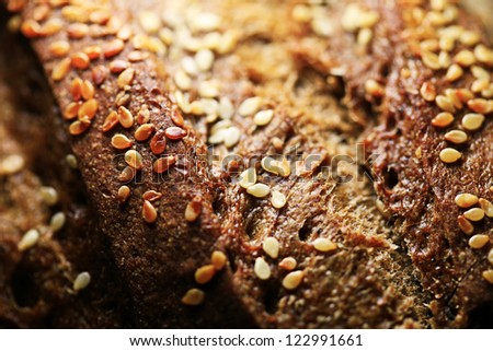 Bread surface with sesame. Macro image.