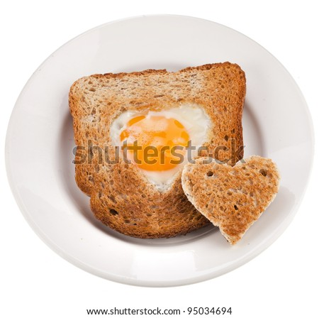 bread toast cut in shape of heart with egg