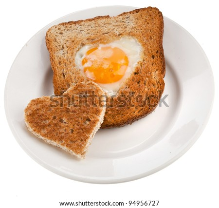 bread toast cut in shape of heart with egg Isolated on white background