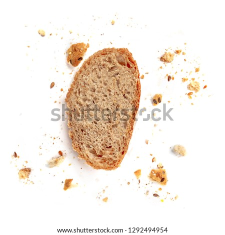 Bread toast  isolated on  white background. Crumbs and Bread slice close up. Bakery, food concept. Top view
