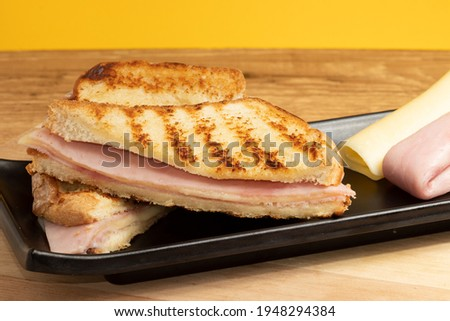 Bread toasted with ham and cheese known as misto quente Foto stock ©
