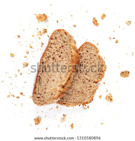 Bread toasts  isolated on  white background. Crumbs and Bread slices close up. Bakery, food concept. Top view