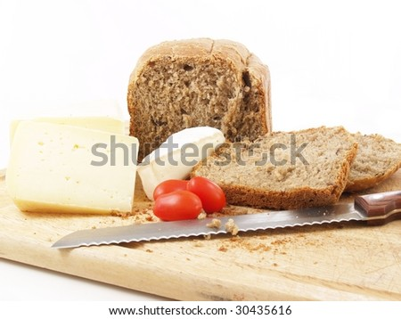 bread, tomatoes and different cheeses on a white background