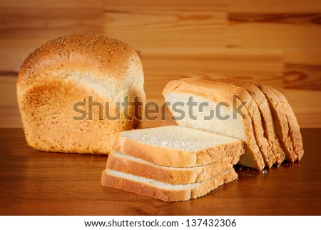 bread: whole and sliced, on wooden desk