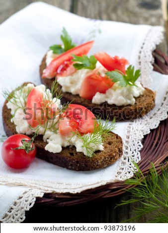 Bread with cottage cheese and tomatoes, selective focus