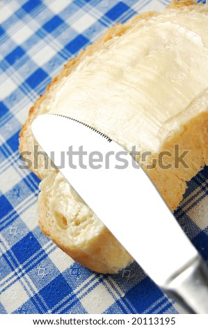 Bread with delicious thick buttered spread over it