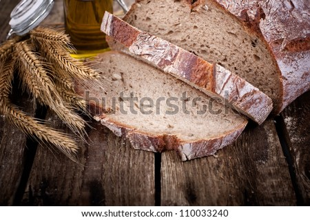 bread with ears of corn on wooden table