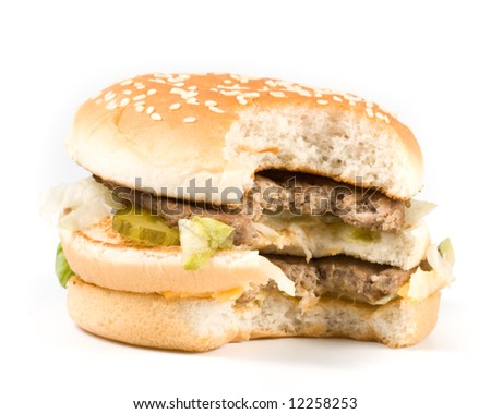 Bread with fried meat, cheese, onion, lettuce and measuring tape isolated on a  white background. - stock photo