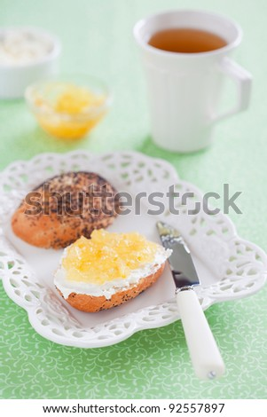 Bread with lemon jam and cream cheese on plate, selective focus