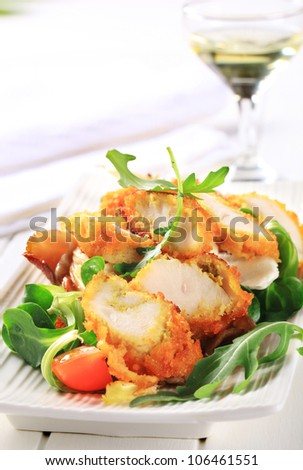 Breaded chicken breast with salad greens and oyster mushrooms