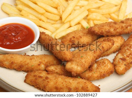 Breaded chicken goujons or nuggets with fries and tomato ketchup