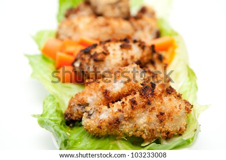 breaded chicken wings with carrot sticks