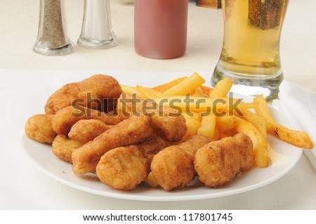 Breaded chicken with french fries and beer