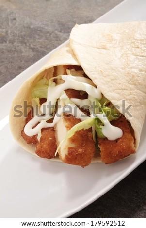 breaded chicken wrap on platter