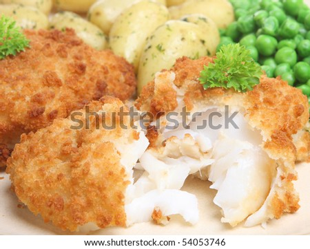 Breaded cod fillet with new potatoes and peas.