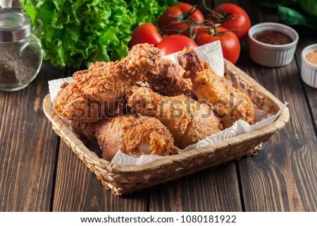 Breaded crispy fried kentucky chicken drumctick in the basket