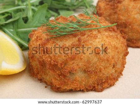 Breaded fishcake with haddock, mashed potato and herbs.