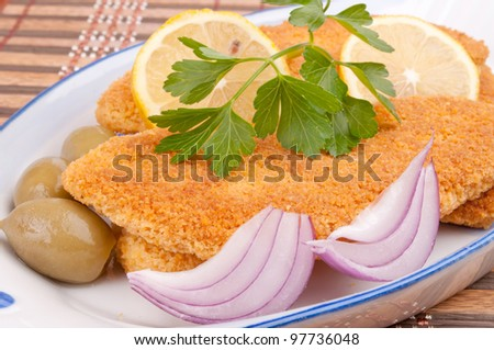 Breaded hake fillets in the fish-shape plate