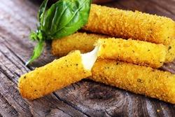 Breaded mozzarella cheese sticks for delicious meal