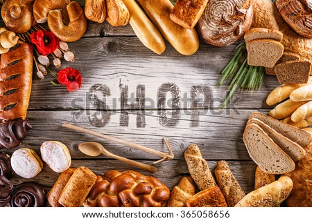 breads, pastries, christmas cake on wooden background with letters, picture for bakery or shop