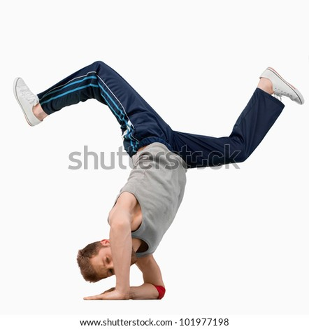 Break dancer doing a hand stand against a white background - stock photo