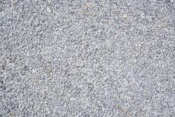 Break stone background. Road gravel. Gravel texture. Crushed Gravel background. Piles of limestone rocks. Asphalt stones on construction site