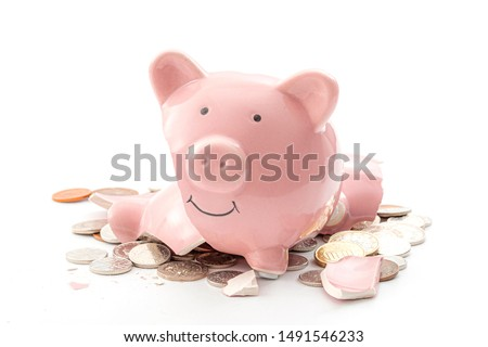 Break the bank, economic downturn and bankruptcy concept theme with a broken piggy bank and scattered coins isolated on white background Stock photo ©
