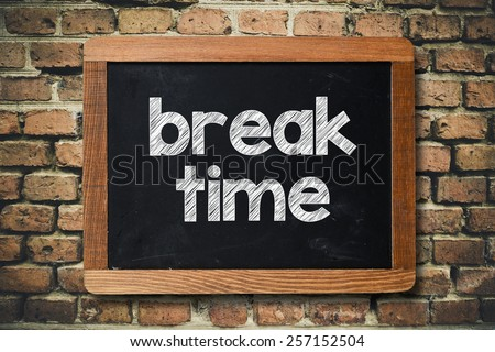 Break time on Blackboard. Break time on Blackboard on bricks wall