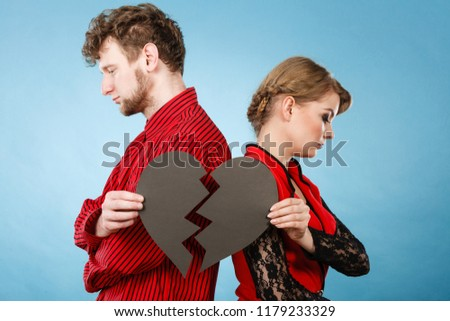 Break up and leave in relationship. Negative emotions between people in love. Young couple with two halves of broken heart. Lovers breaking up. #1179233329
