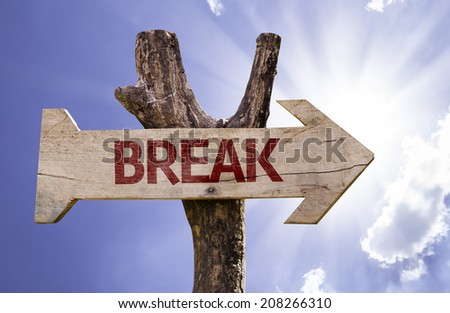 Break wooden sign on a beautiful day
