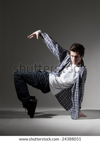 breakdancer showing his skill against grey background