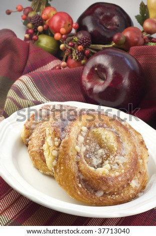 Breakfast Apple Danish on a plate, vertical with copy space, selective focus, low key