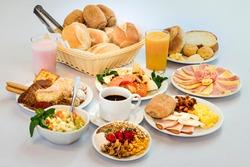 breakfast background white breads coffee basket juice ham cheese sweet strawberries fruits loin milk